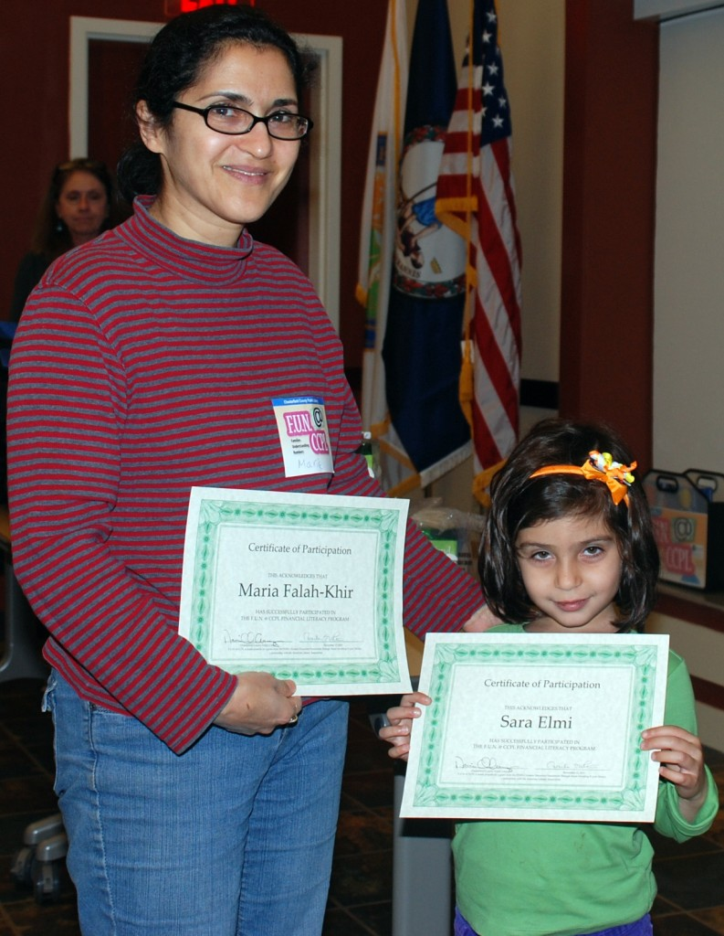 Sarah and her mom, celebrate their accomplishments at the F.U.N. @ CCPL graduation ceremony at the library.